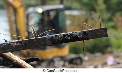 Burnt wood and nails. Shallow DOF. - Burnt piece of lumber...