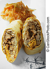 Burrito with grilled beef and kimchi closeup
