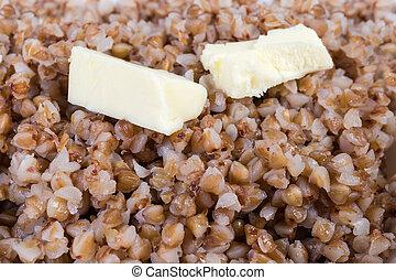 burro, pezzi, grano saraceno, selettivo, primo piano, fuoco, porridge