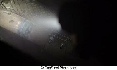 Burst pipe repair. Plumbers installing pipe leak repair...