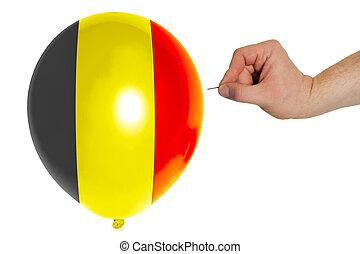 Bursting balloon colored in national flag of belgium