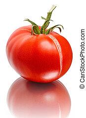 Bursting of the tomato on white