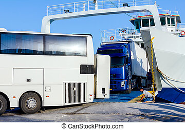 Bus and truck are exit from ferryboat, unloading