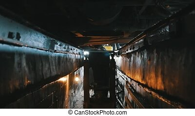 Bus bottom is repaired from large hole with a special rod in...