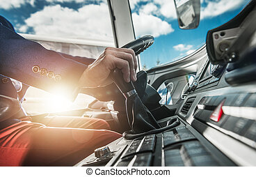 Bus Driver Behind Wheel Changing Gears. - Professional Coach...