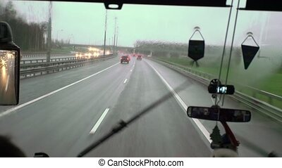 Bus driving at rainy day window