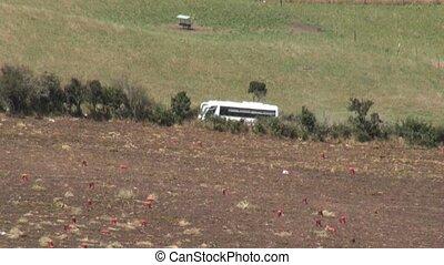 Bus Driving Through Farmland