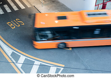 bus in blurred motion on city road