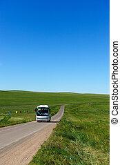 Bus in grassland - Bus in Hulun Buir grassland of...