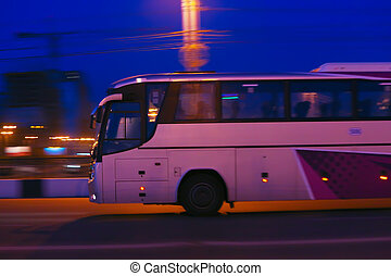 bus moves at night - bus moves on city street at night