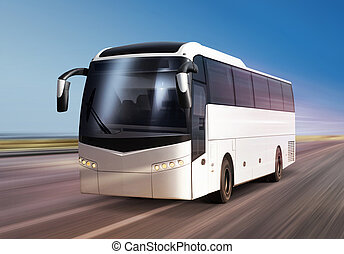 bus on road - white bus moves on divided highway
