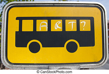 Bus stop sign with 'art' written on it