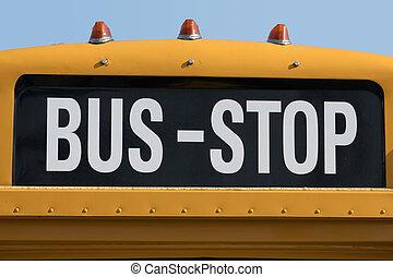 bus stop written on yellow school bus