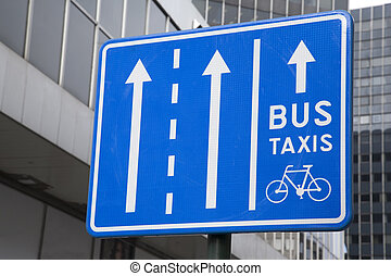 Bus, Taxi and Bicycle Sign in Urban Setting