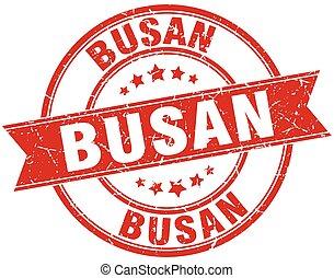 Busan red round grunge vintage ribbon stamp