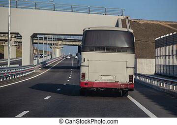 Buses on the highway under railway bridges