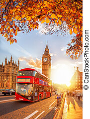 Buses with autumn leaves against Big Ben in London, England, UK