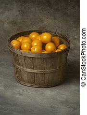 Bushel basket of fresh oranges