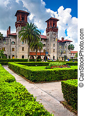 Bushes and former Alcazar Hotel, now the St. Augustine City Hall and Lightner Museum, in St. Augustine, Florida.
