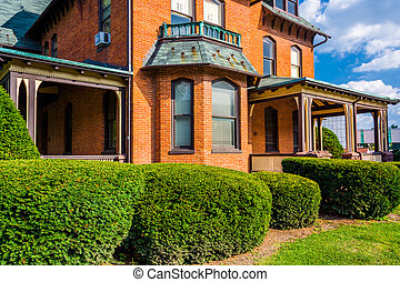 Bushes in front of an old house in Spring Grove, Pennsylvania.