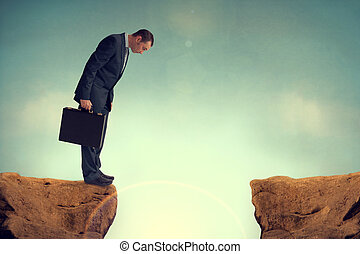 businesman facing a challenge - businessman nervously facing...