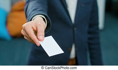 Businesman Showing a Blank Piece of Paper