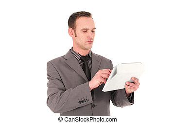 Businesman working on a handheld tablet