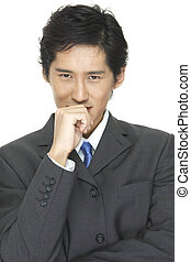 Business 1 - An asian businessman in grey suit with blue tie