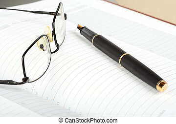 Business a still-life with fountain pen and glasses