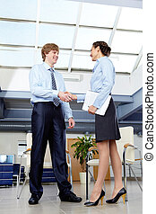 Business acquaintance - Businesswoman and businessman...