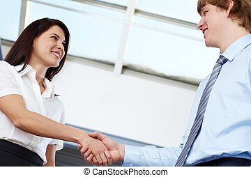 Business acquaintance - Businesswoman shaking hands with...