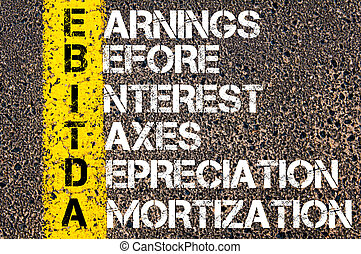 Business Acronym EBITDA Earnings before Interest, Taxes, Depreciation, and Amortization. Yellow paint line on the road against asphalt background. Conceptual image