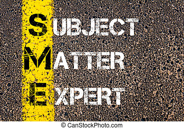 Business Acronym SME as Subject Matter Expert. Yellow paint line on the road against asphalt background. Conceptual image