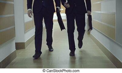 Business Activities - Two unrecognizable businessmen...
