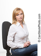 business adult woman sitting on a chair. Isolated on white.