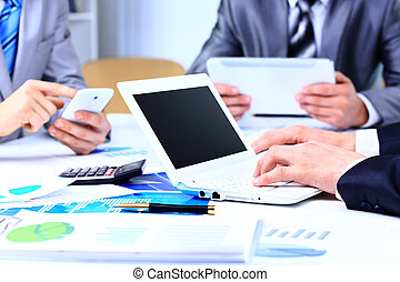 Business adviser analyzing financial figures denoting the...