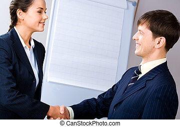 Business agreement - Business people shaking hands making an...