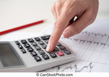 Business analyst calculate revenue on calculator