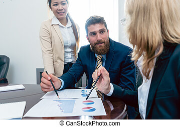 Business analyst smiling while interpreting financial...