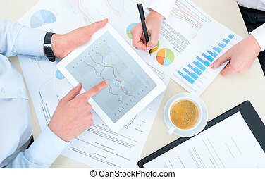 Business Analytics - Business team analyzing income charts...