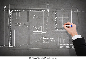 close up of businessman drawing blueprint