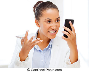 african woman shouting into smartphone