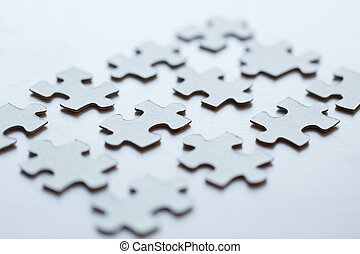 close up of puzzle pieces on table