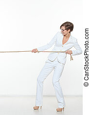 business and education concept - businesswoman pulling rope
