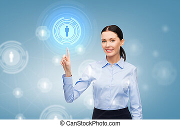 smiling businesswoman pointing finger at you - business and...