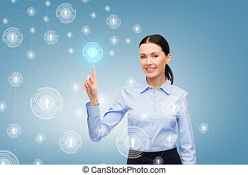 smiling businesswoman pointing finger at you - business and ...
