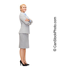 smiling businesswoman with crossed arms - business and...