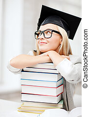 student in graduation cap - business and education concept...