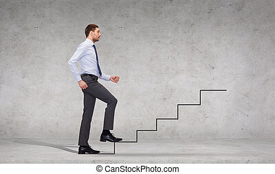 serious businessman stepping on step - business and ...