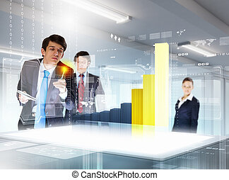 young businesspeople clicking on icon of high-tech image